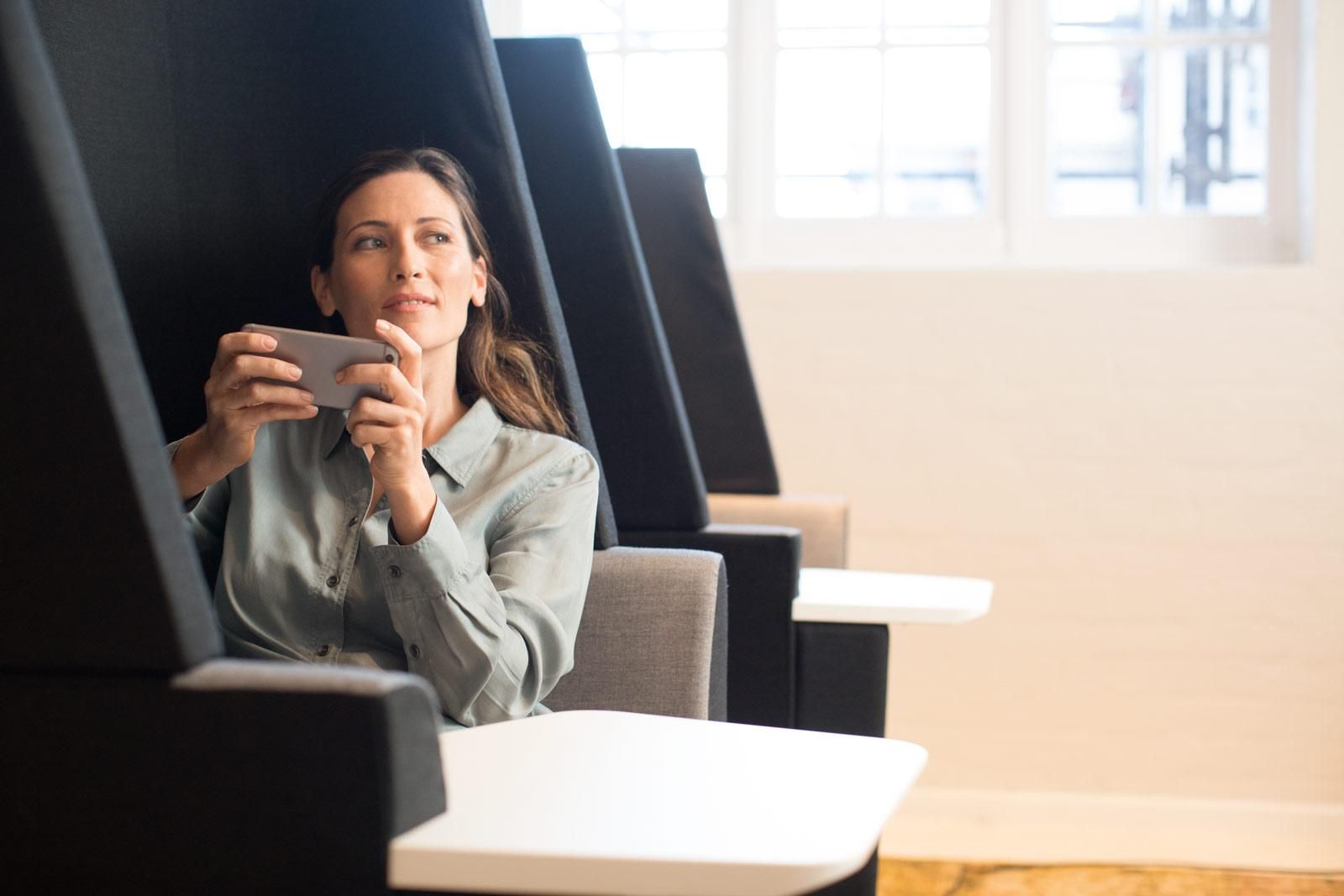 woman-sitting-in-seat-lounge-with-mobile-phone